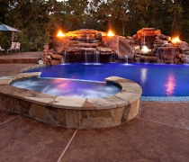 Custom-Grotto-Waterfall-Slide-Fire-Bowls-and-Spa