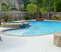 Custom-Pool-and-Spa-with-Jumping-Rock-Sundeck-Water-Feature-and-Fire-Pit