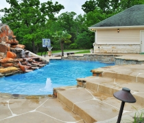 Sport-Pool-with-Sundeck-Custom-Slide-Waterfall-and-Basketball