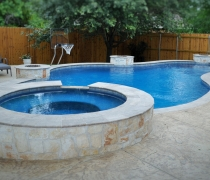 custom-pool-and-spa-with-fire-bowls-and-basketball-goal