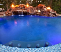 custom-pool-fire-bowls-slide-waterfall-sundeck-jets-custom-tile-bar