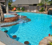 custom-pool-spa-flagstone-sundeck-steps-benches-grotto-rock-wall-custom-tile-sunken-bar