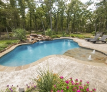 freeform-swimming-pool-with-rock-waterfall-bubblers-and-beach-entry