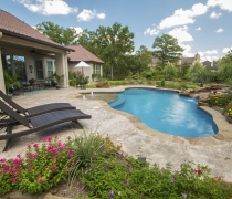 custom-pool-with-rock-waterfall-bubblers-and-sundeck