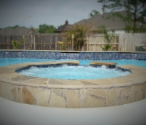 Flagstone-and-Tile-Spa-with-Water-Feature-Wall