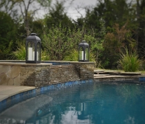 Stacked-Stone-Spa-Spillover-with-Flagstone-River-Bed