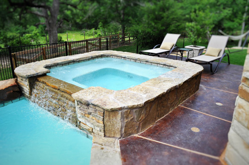 Custom-Flagstone-Spa-with-Rock-Spillover