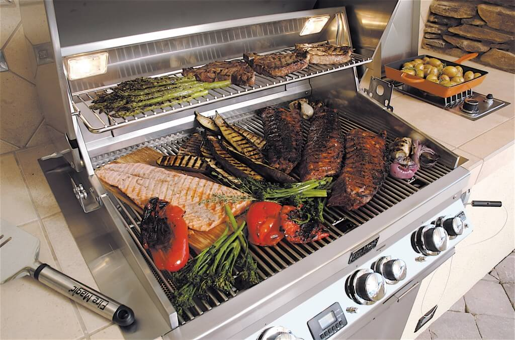 Barbeque grill loaded with healthy fish and vegetables.