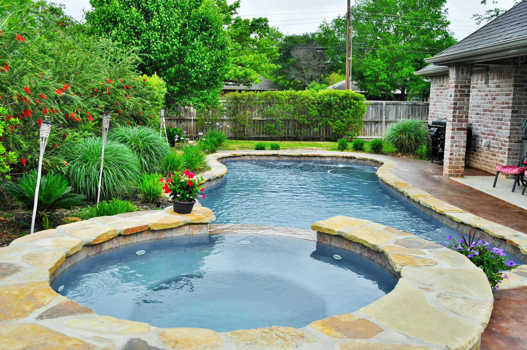 Backyard bryan spring college station brazos valley for Designer pools and spas