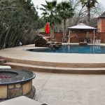 Custom-Entertainment-Pool-with-Outdoor-Kitchen-Fire-Pit-and-Waterfall